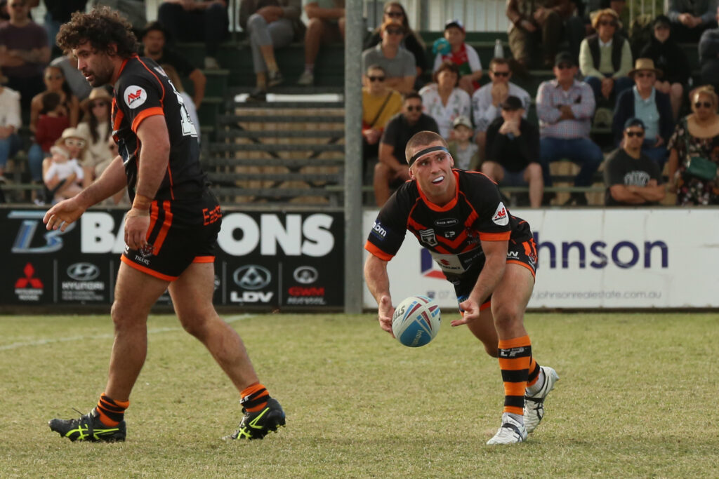 Aaron Booth with the ball.  Photo by Jorja Brinums/QRL